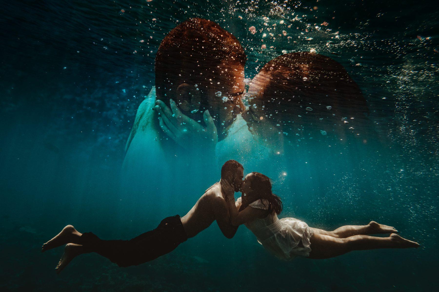 Couple kissing underwater