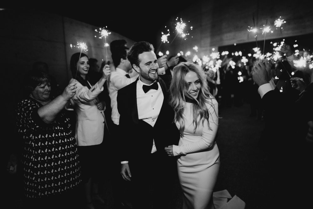 Wedding couple with a sparkler exit