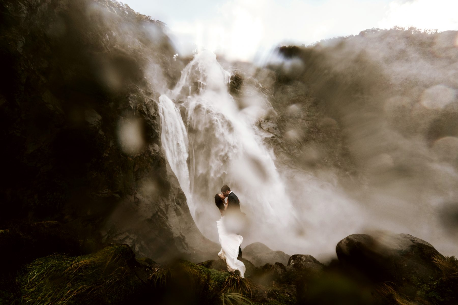Wedding couple in front of a waterfall