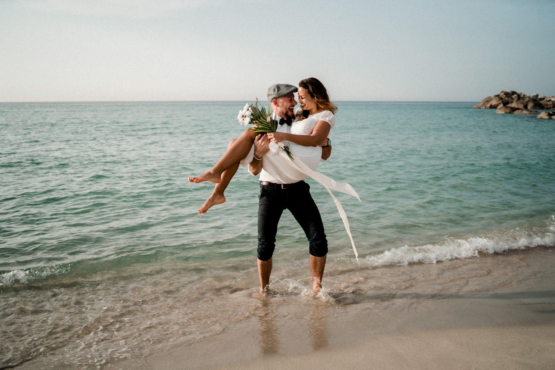 Bride and Groom having fun on the beach