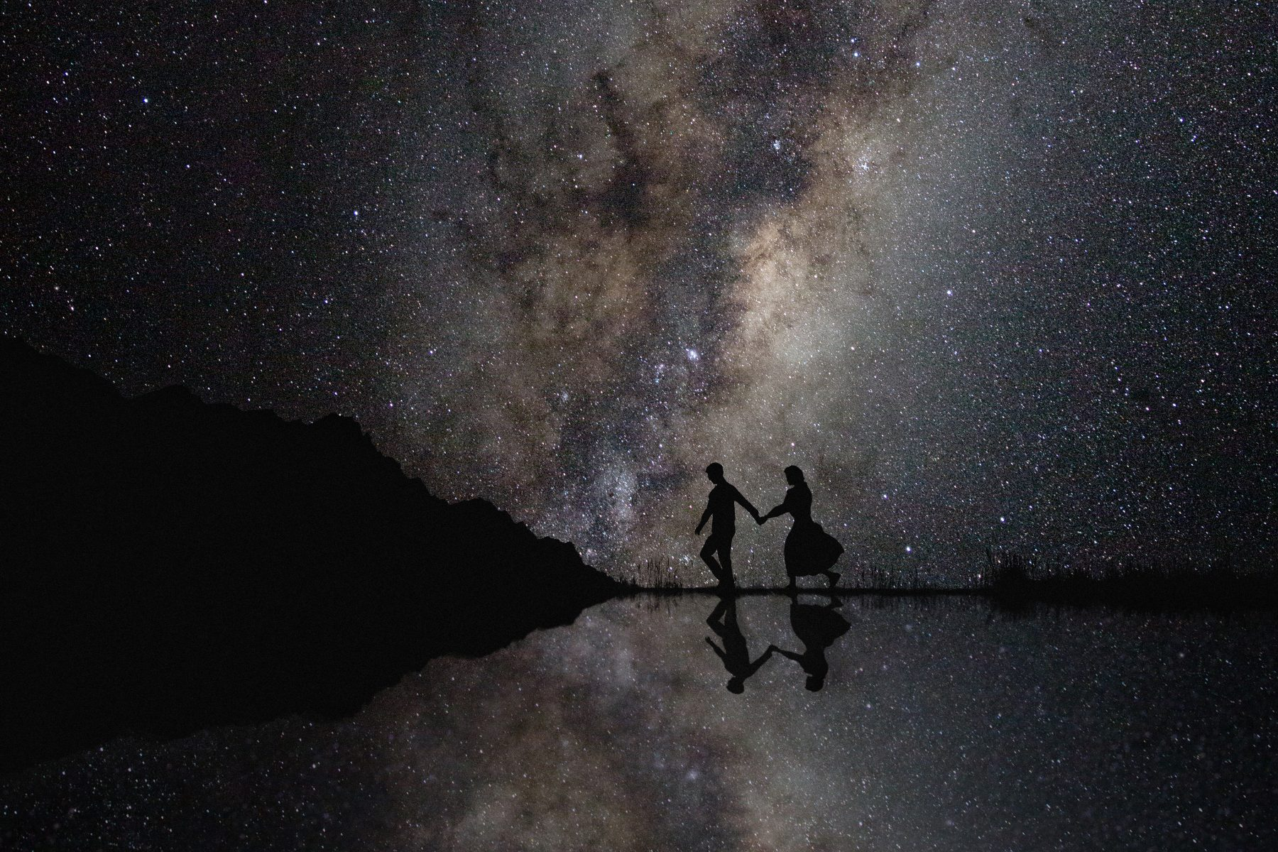Wedding couple with the milkyway stars in the background.